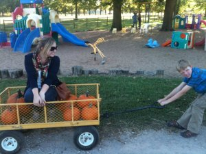 A couple years ago, I made my nephew pull me around the pumpkin patch. As you can see by his face, I'm basically weightless. The cart was really heavy, though.
